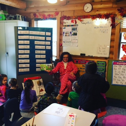 Mrs. Wood Reading to her class in PJs.JPG